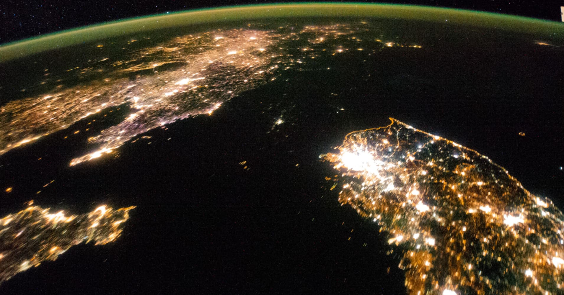 Flying over East Asia in January 2014, astronauts took this night image of the Korean peninsula. Dark North Korea is difficult to detect, between China and South Korea.