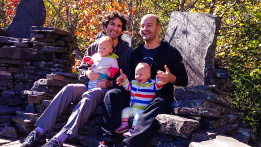 Misha Tismenetsky, left, and Misha Rubin with Lia and Osi.