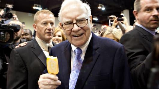 Warren Buffett eats a Dairy Queen ice cream bar prior to the Berkshire Hathaway annual meeting in Omaha, Nebraska.