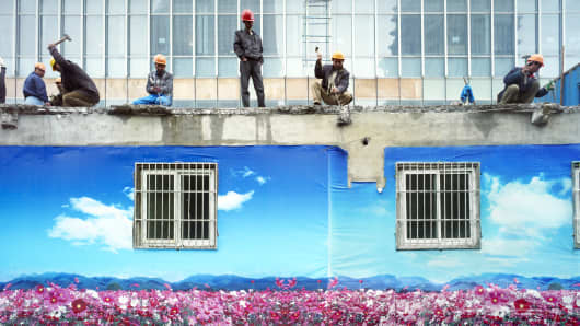Chinese construction crew dismantles a building in Pudong, Shanghai, China.