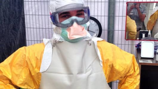 Dr. Craig Spencer working with Doctors Without Borders treating ebola patients in West Africa.