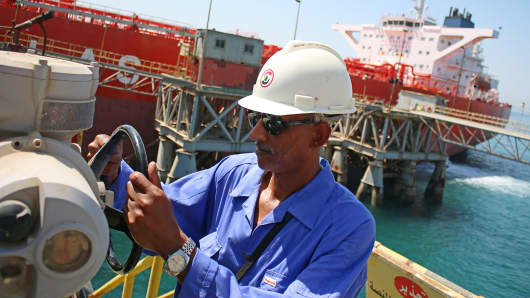 An operator works near a tanker docked at a floating platform offshore the southern Iraqi port city of Al Faw.