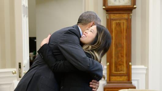 President barack obama gives a hug to dallas nurse nina pham in the