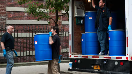 Employees from Bio Recovery Corporation carries equipment into 546 West 147th Street, the apartment building of Dr. Craig Spencer, the doctor recently diagnosed with Ebola, on October 24, 2014 in New York City.