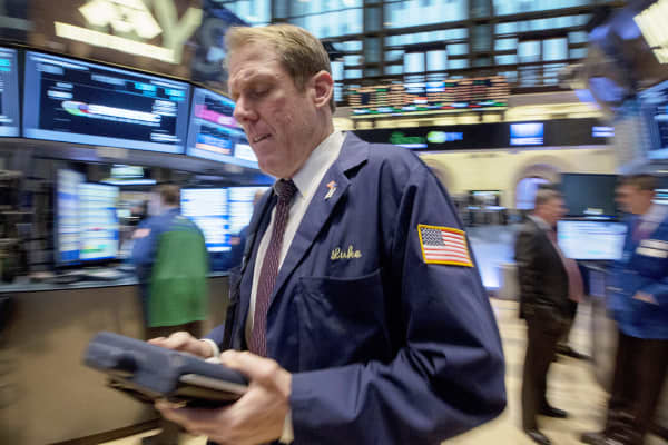A trader works on the floor of the New York Stock Exchange, Oct. 24, 2014.