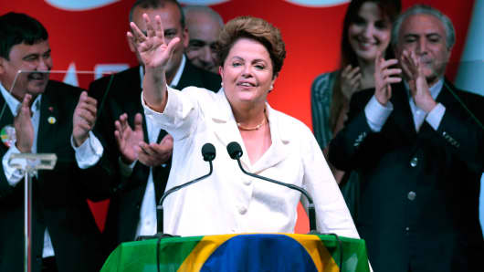 Brazil's president and Workers' Party (PT) presidential candidate Dilma Rousseff reacts during news conference after the disclosure of the election results in Brasilia Oct. 26, 2014.