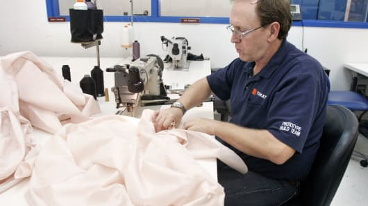 A Takata employee sews an airbag at Takata's current crash-testing facility in Auburn Hills, Michigan.