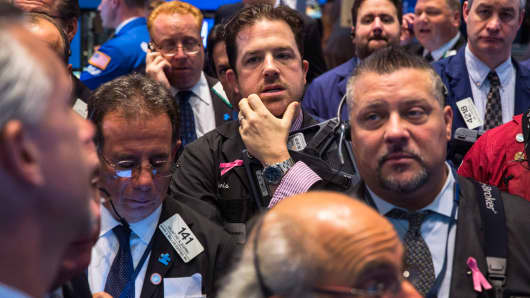 Traders on the floor of the New York Stock Exchange await the Fed's decision Wednesday.