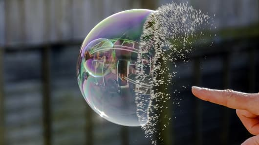 Finger busting soap bubble