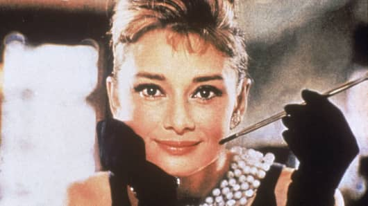 "Audrey Hepburn is shown in her role as Holly Golightly the film, ""Breakfast at Tiffany's."""