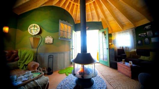 "The ""Luck O' The Irish Cottage"" in Orange County, CA, is a quaint, Celtic-themed dwelling in an olive tree.  The unique round space features the peat-burning fireplace and charming décor of a real Irish cottage."