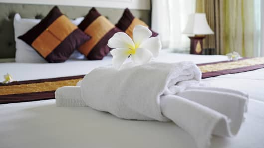 Flower on towels in hotel room