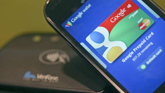 The Google Mobile Wallet app for cardless payments is displayed on a smartphone screen at the Mobile World Congress.