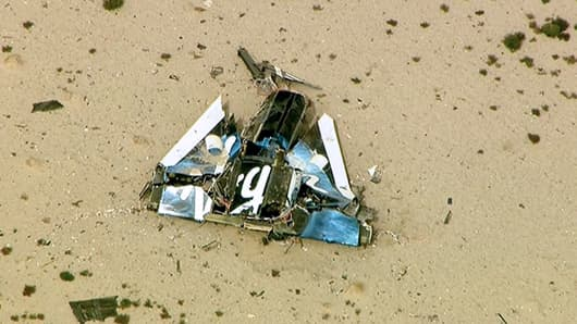 Debris from the crashed Virgin Galactic SpaceShipTwo craft is shown in this video still.