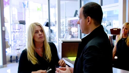 "Marcus Lemonis of CNBC's ""The Profit"" with Carolyn Devito, the owner of Unique Salon &Spa"