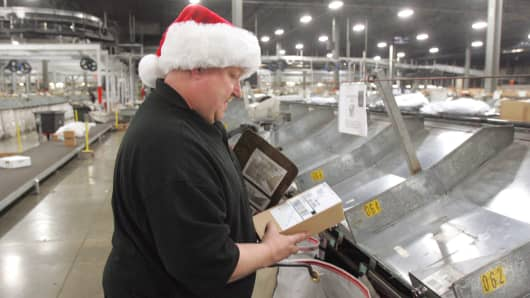 File photo: A worker in a UPS sorting facility around the holidays.