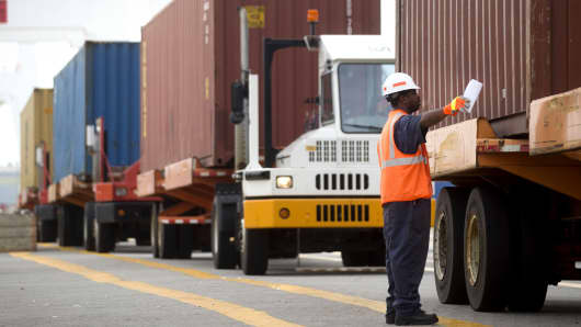 A spotter lines up a truck before a container is loaded a ship in the Seagirt Marine Terminal at the Port of Baltimore in Baltimore, Maryland.