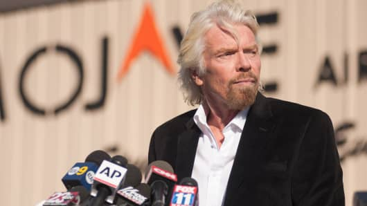 Virgin founder Sir Richard Branson speaks at a press conference at the Mojave Air and Space Port in Mojave, California on November 1, 2014.