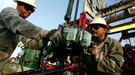 Oil workers conduct a drill in a petroleum well in Lagunillas at the east coast of Lake Maracaibo near Maracaibo City in Venezuela.