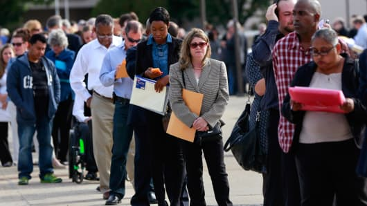 People wait in line to enter the Nassau County Mega Job Fair at Nassau Veterans Memorial Coliseum in Uniondale, New York October 7, 2014.
