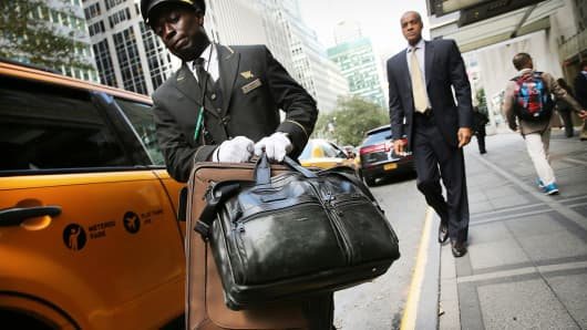 An employee helps a guest at the Waldorf Astoria in New York City.