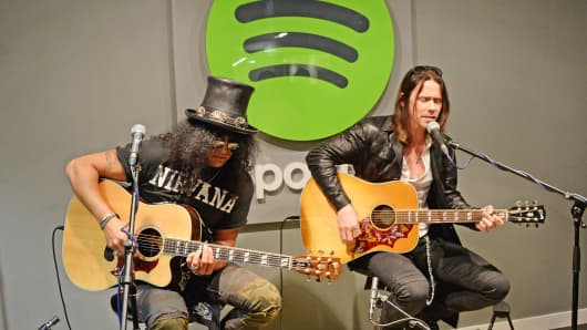 From left: Slash and Myles Kennedy play a Spotify Session at its London office on June 3, 2014.