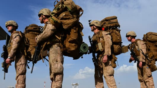 US Marines board a transport aircraft headed to Kandahar, Afghanistan