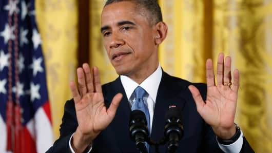 President Barack Obama gestures while speaking at the White House, November 5, 2014.