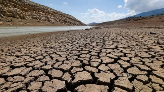 The dried cracked bed of the Qaraoun artificial lake is seen in West Bekaa, Lebanon, Sept. 19, 2014.