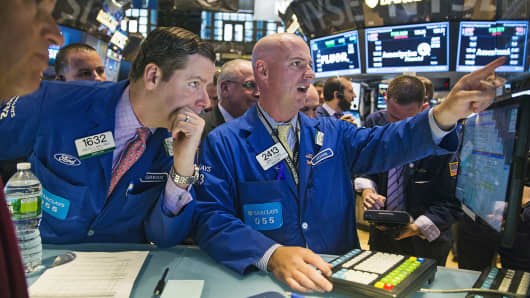 Traders work on the floor of the New York Stock Exchange, Nov. 7, 2014.