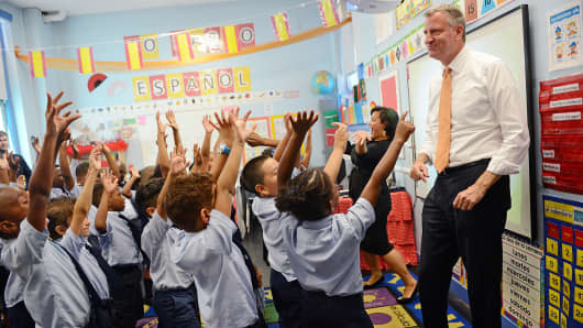 New York Mayor Bill de Blasio visits a second grade Spanish class at Amber Charter School in New York, Sept. 4, 2014.