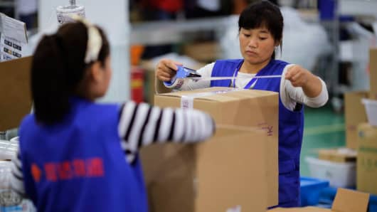 Employees work at an Alibaba Group warehouse, Hangzhou, Zhejiang province.