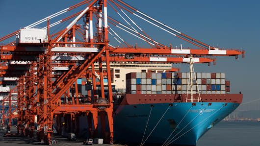 A gantry crane moves a container at the Port of Gwangyang in Gwangyang, South Korea.