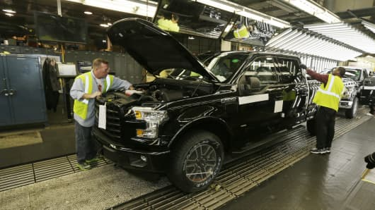 The new Ford F-150 truck is examined at the Rouge Truck Plant in Dearborn, Mich. on Nov. 6, 2014.
