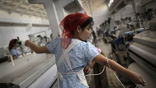 A North Korean woman stretches a string of yarn at the Kim Jong Suk Pyongyang textile factory in North Korea. It's the country's largest textile factory with 8,500 workers.