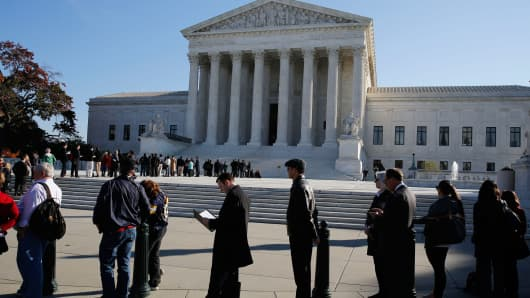 People wait to enter the U.S. Supreme Court, Nov. 10, 2014.