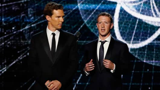 British actor Benedict Cumberbatch (L) and Mark Zuckerberg (R), founder and CEO of Facebook, speak on stage during the 2nd annual Breakthrough Prize Awards at the NASA Ames Research Center in Mountain View, California November 9, 2014.
