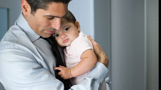 Father holding infant daughter