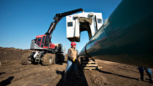 A weld shack is moved toward a pipe joint during construction of the Keystone XL Pipeline in Atoka, Oklahoma.
