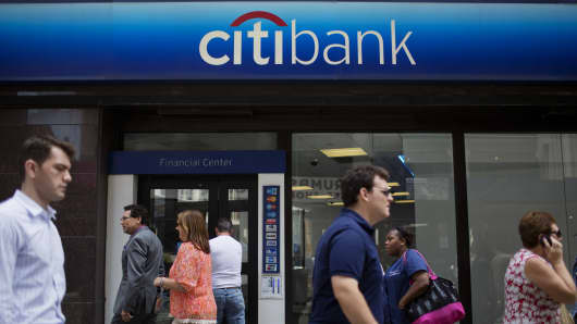 Pedestrians walk past a Citigroup Inc. Citibank branch in New York.