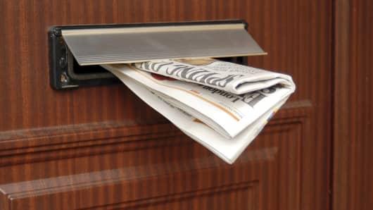 Newspaper delivered in mail slot