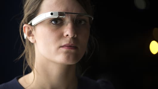 A woman wears Google Glass as she visits an art exhibition at the Grand Palais in Paris, Nov. 6, 2014.
