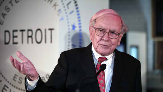 Warren Buffett, Chairman and CEO of Berkshire Hathaway answers questions at a press conference at which Detroit was named the 11th city to be included in the $500 million Goldman Sachs initiative at Ford Field.