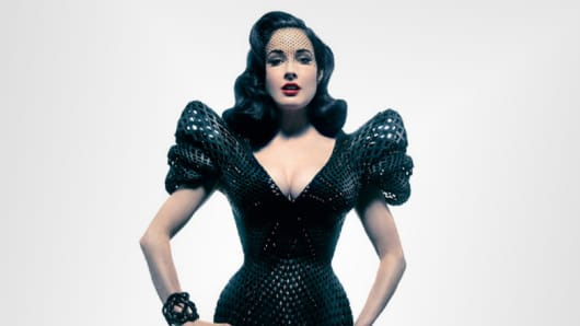 Dita Von Teese models Bitonti's 3D printed dress with over 12,000 Swarovski crystals and  3,000 moving parts specifically designed for her.