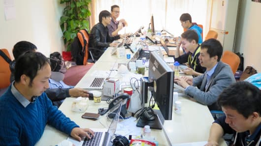 A group of programmers work out of Jack Ma's old apartment in Hangzhou, China.
