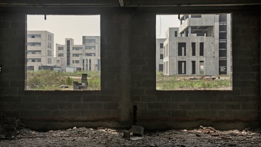 Abandoned buildings are shown at the Caofeidian Environmental Industries Park in Caofeidian, China.