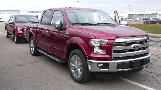 New 2015 Ford F-150 trucks are driven to the lot after coming off the assembly line at the Ford Dearborn Truck Plant November 11, 2014 in Dearborn, Michigan.