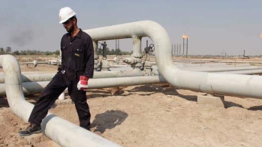 A worker at the Nahr Bin Umar field, Iraq.