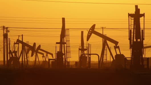 Pump jacks are seen at dawn in an oil field over the Monterey Shale formation in California.