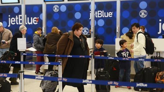JetBlue passengers at Logan International Airport, Boston.